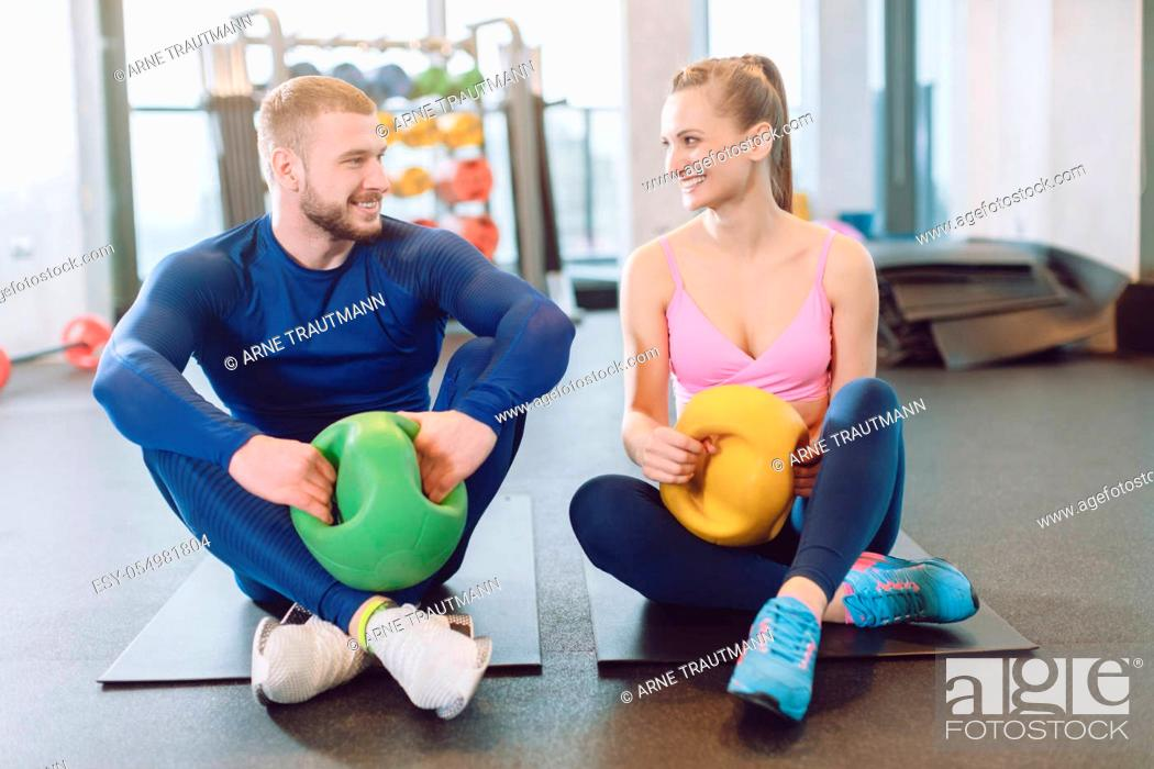 Stock Photo: Man and woman doing stomach or abdominal exercises together in core training session.