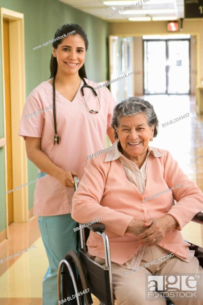 Stock Photo: Senior Hispanic woman in wheelchair.