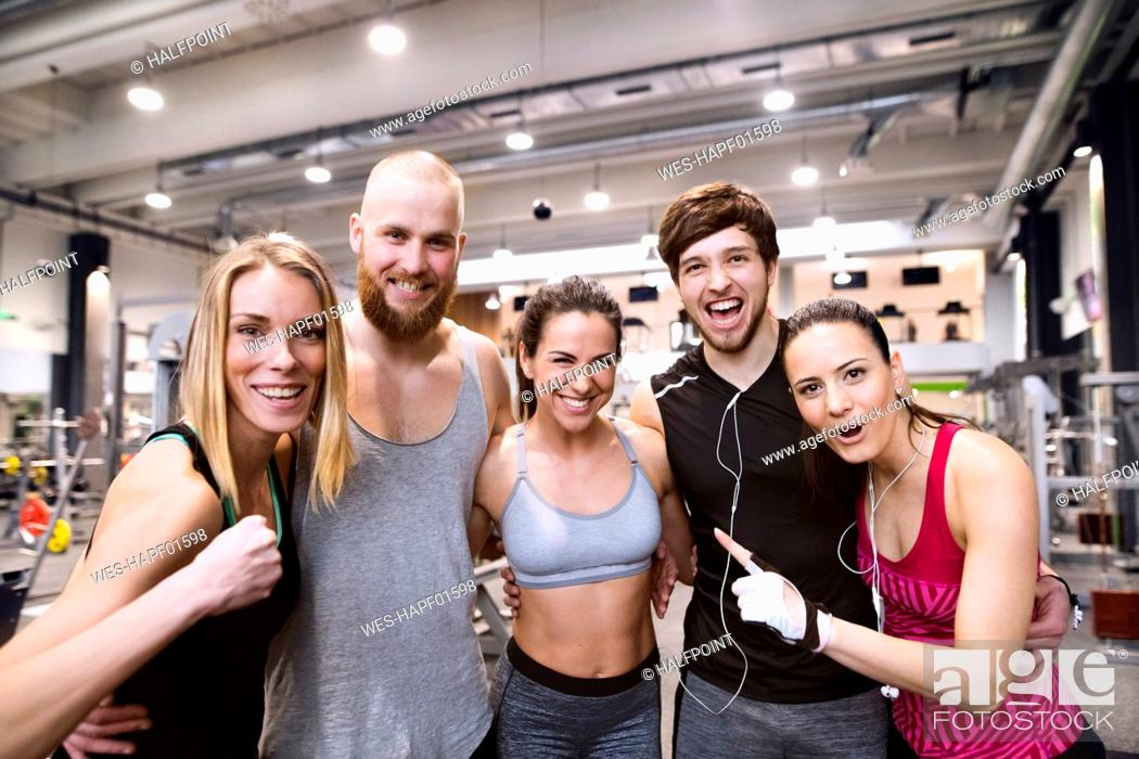 Stock Photo: Fit friends having fun in gym.