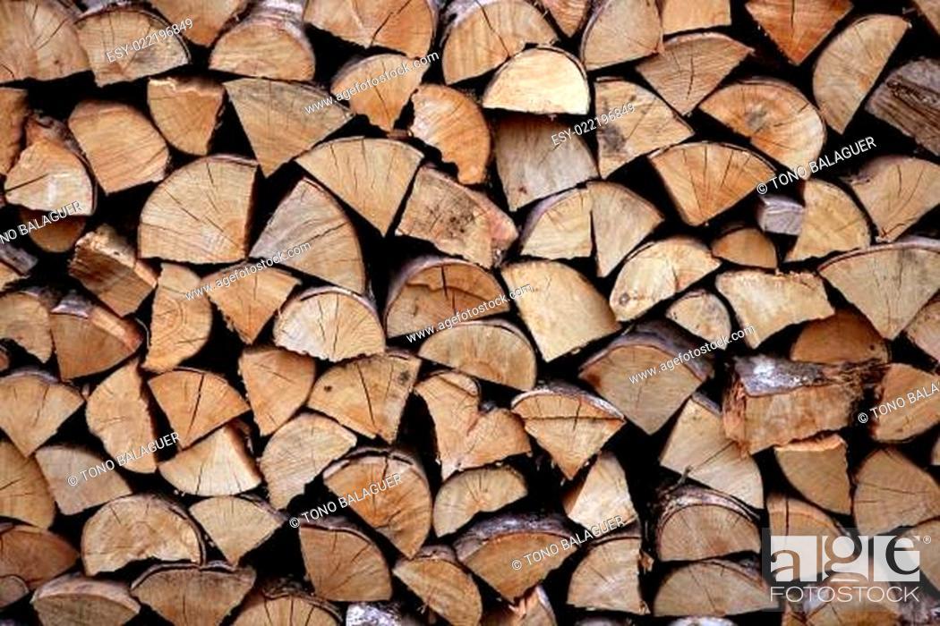 Stock Photo: Cut firewood stack logs as pattern.