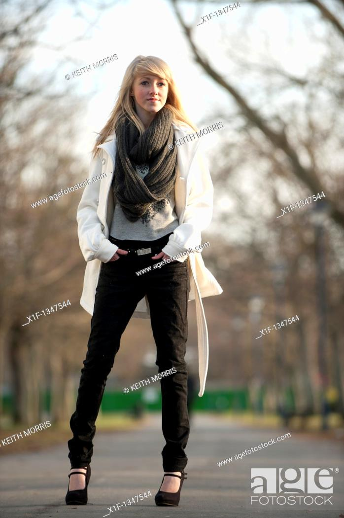 Stock Photo: A slim blonde 14 year old teenage girl outdoors day UK.