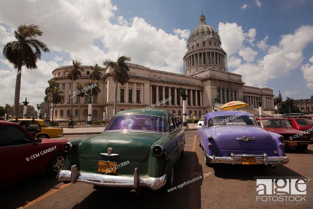 Old American cars used as taxi at the parking lot in front of the ...