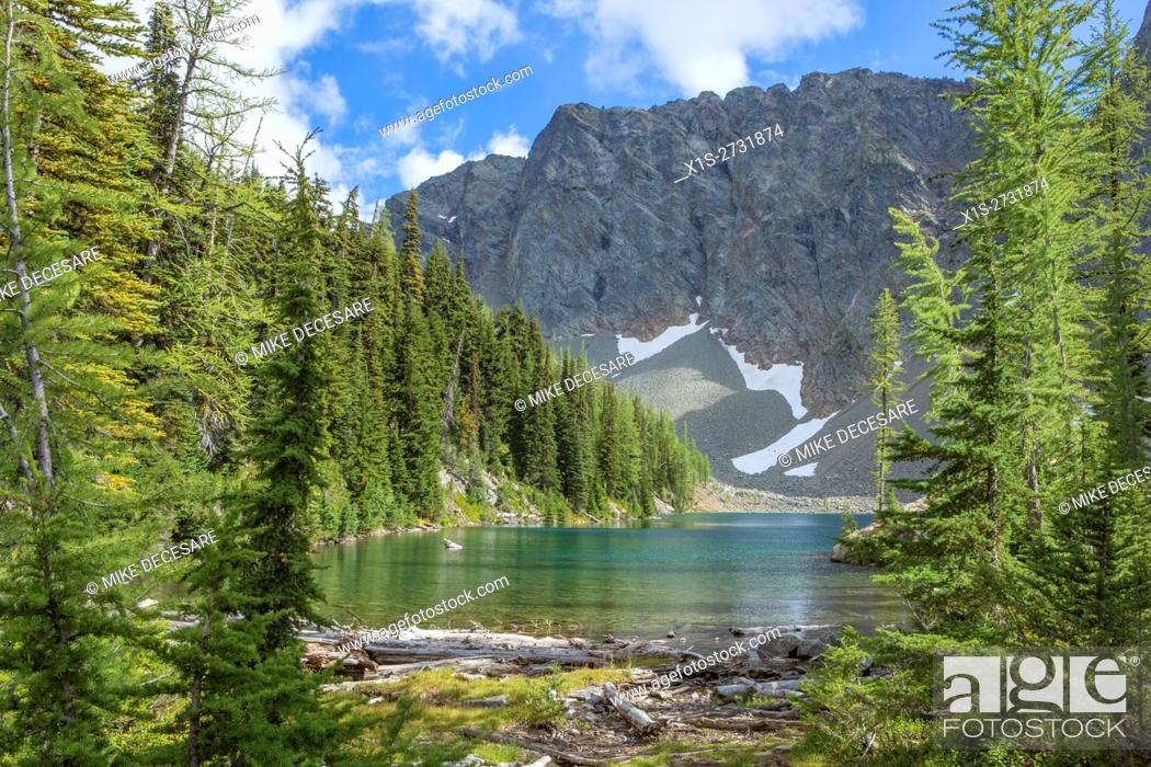 Stock Photo: Old and new growth Evergreen trees frame pristine Blue Lake in the North Cascade range.