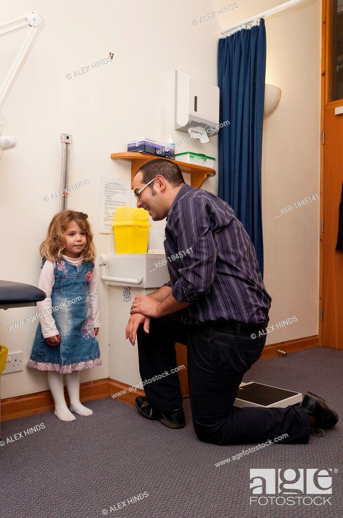 Stock Photo: GP Doctor surgery patient consultation  Child height measurement.