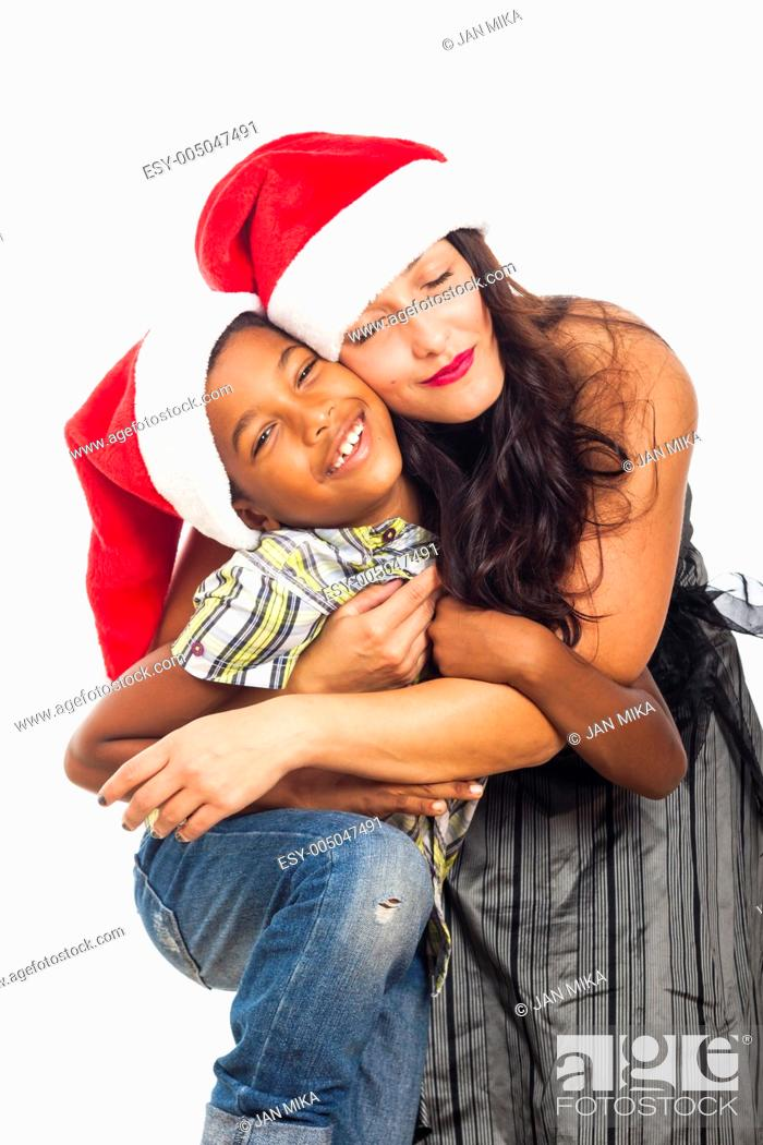 Stock Photo: Christmas portrait of beautiful happy young woman hugging child boy, isolated on white background.