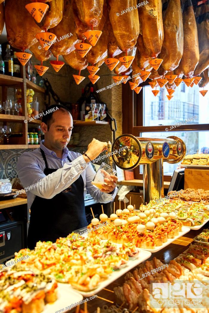 Stock Photo: Waiter serving beer, Ham, Pintxos, Bar Restaurante Portaletas, Parte Vieja, Old Town, Donostia, San Sebastian, Gipuzkoa, Basque Country, Spain.