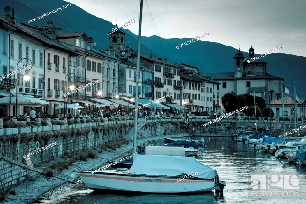Stock Photo: Italy, Piedmont, Lake Maggiore, Cannobio, Piazza Vittorio Emanuele III, view from the harbor, dusk.