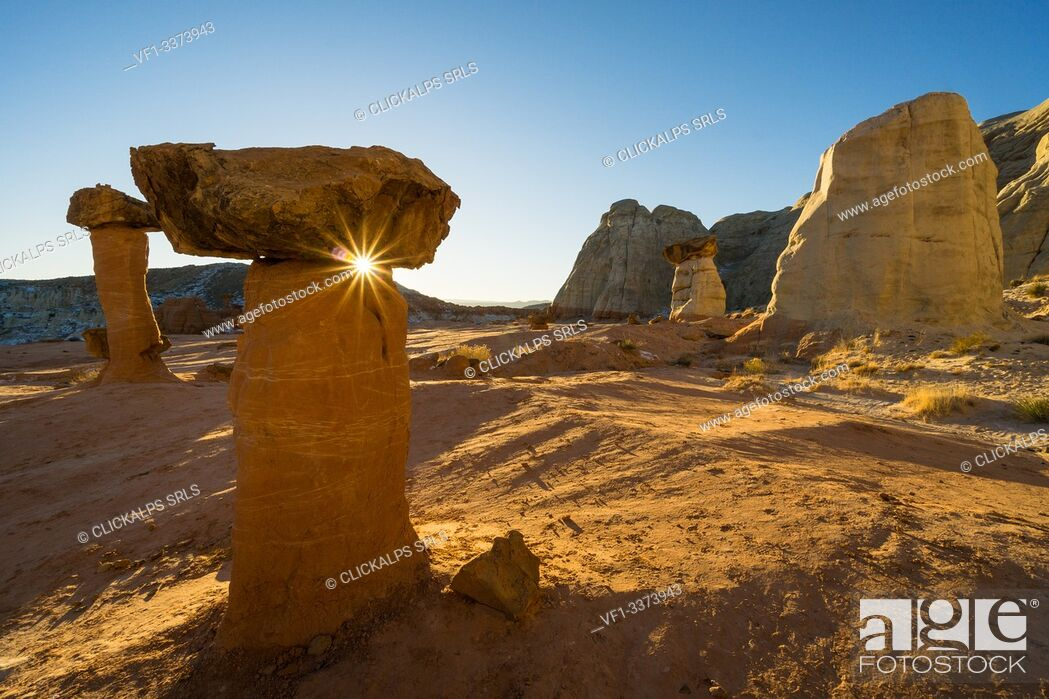 Stock Photo: Sunset at The Toadstools, a land of balanced rocks formations located in Grand Staircase Escalante National Monument, Page, Utah, Usa.