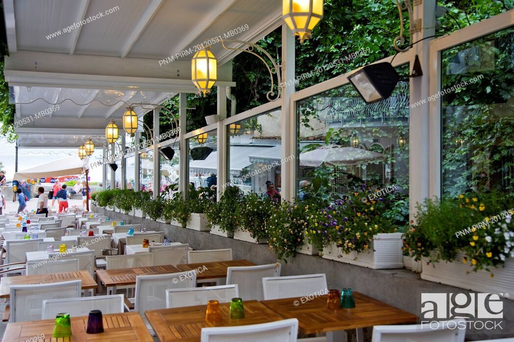 Stock Photo: Empty tables and chairs in a restaurant, Positano, Amalfi, Province of Salerno, Campania, Italy.