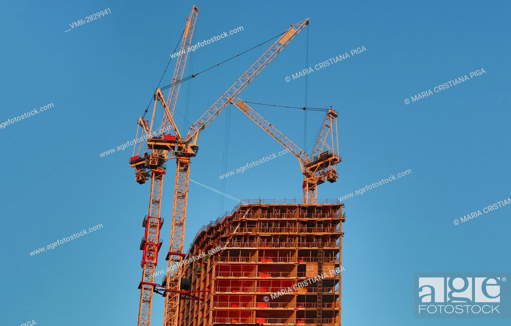 Stock Photo: Cranes and unfinished buidling in the Elephant and castle area in London.