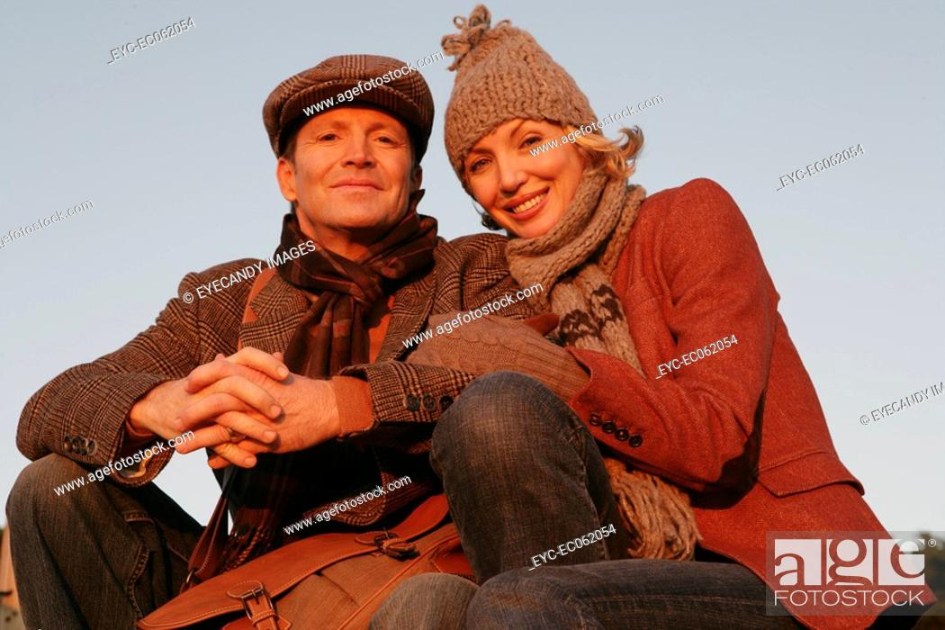 Stock Photo: Mature couple wearing hat and scarves.