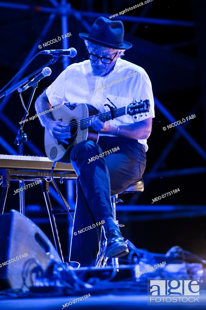 Stock Photo: The Roman singer-songwriter Niccolò Fabi performs in concert at the Bike-In Arena in Mantua accompanied by the musicians Pier Cortese and Roberto Angelini.