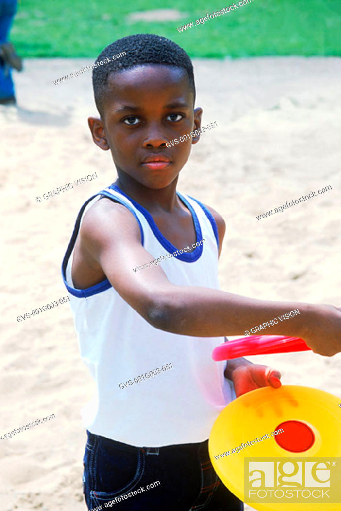 Stock Photo: Young boy playing with a Frisbee.