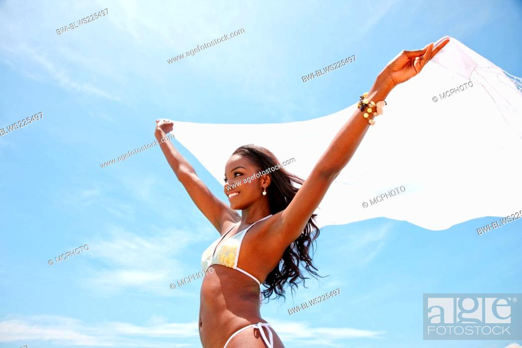 6b29938a474da Stock Photo - beautiful black bikini woman having fun at the beach