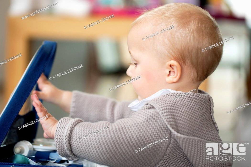 Stock Photo: Close-up of a baby girl playing.