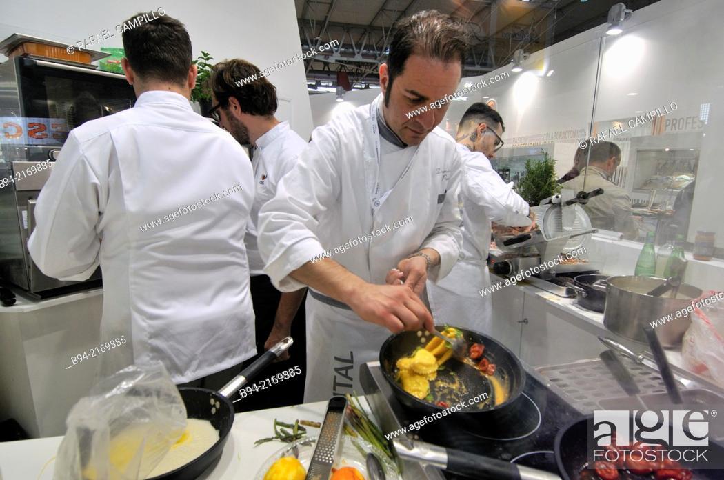 Stock Photo: Cooks working in Alimentaria, International Food and Drinks Exhibition, Fira de Barcelona. L'Hospitalet de Llobregat, Barcelona, Catalonia, Spain.