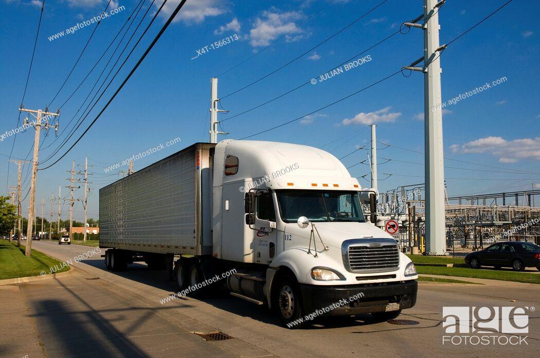 Stock Photo: A white truck hauling cargo through Chicago, Illinois.