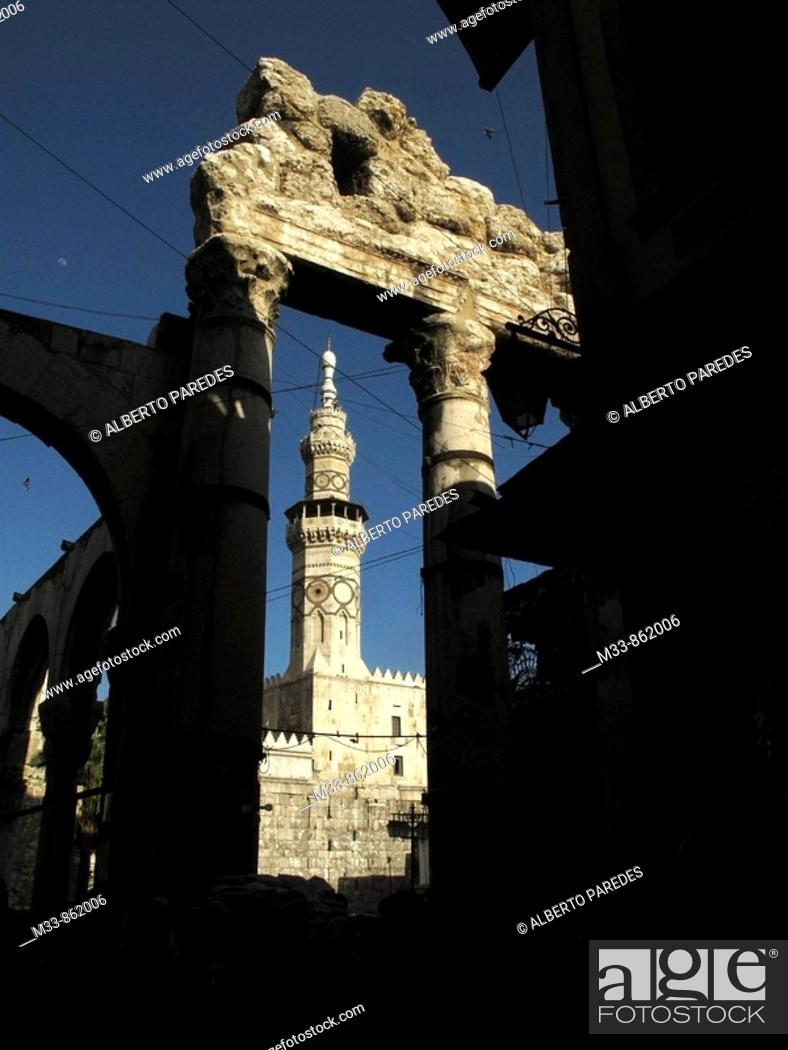 Umayyad Mosque minaret and ruins of the Roman temple of