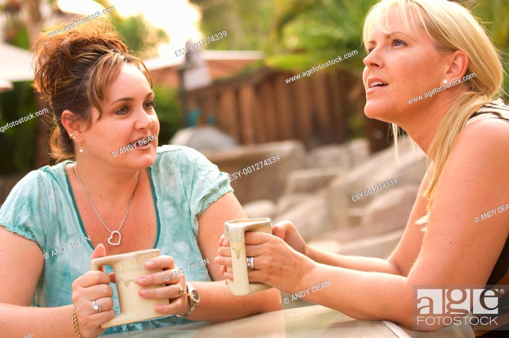 Stock Photo: Girlfriends Enjoy A Conversation.