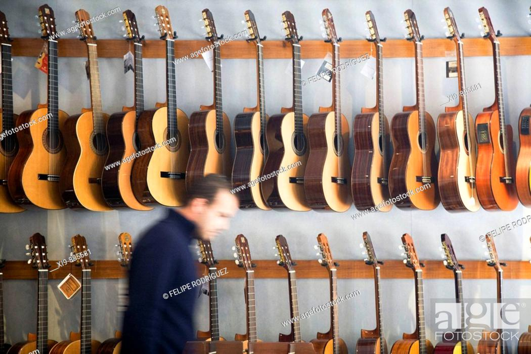 Stock Photo: Guitars in a music store. Seville, Andalusia, Spain.