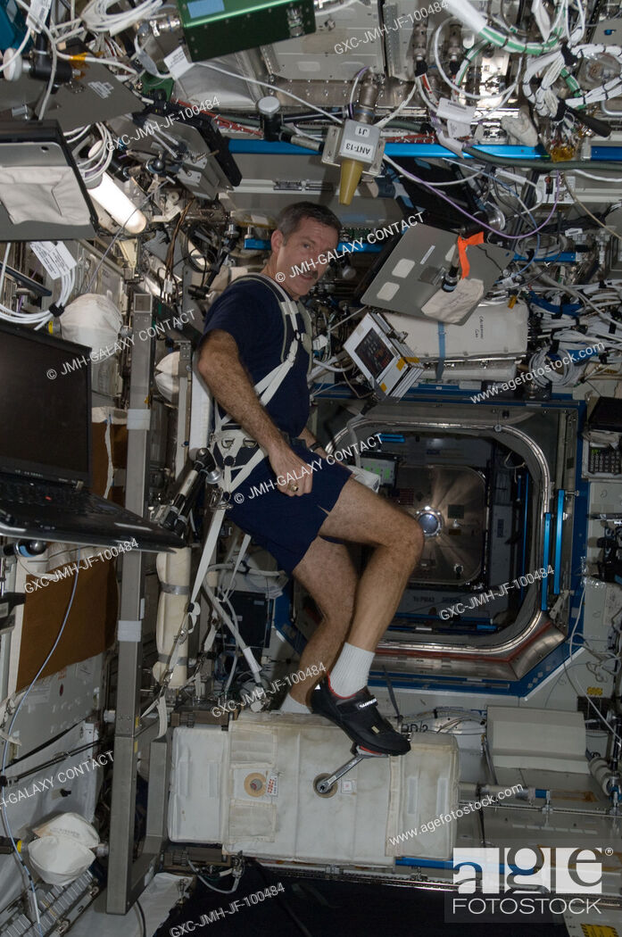 Stock Photo: NASA astronaut Dan Burbank, Expedition 30 commander, exercises on the Cycle Ergometer with Vibration Isolation System (CEVIS) in the Destiny laboratory of the.