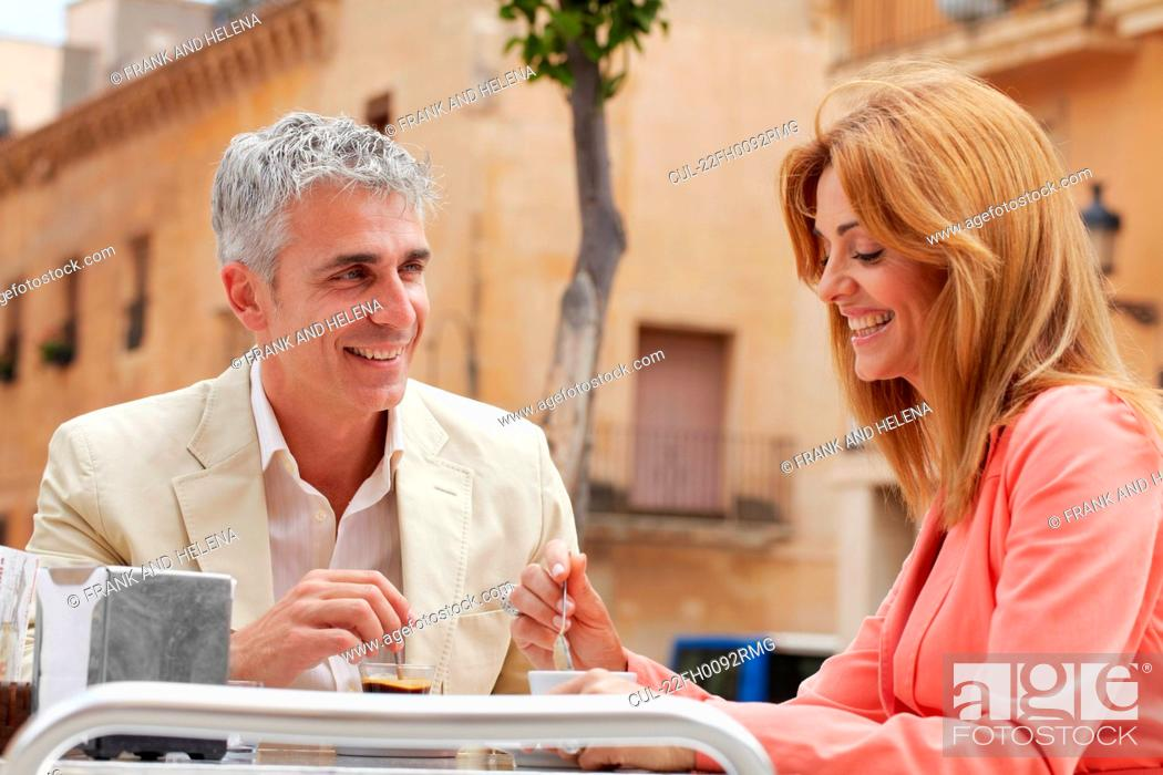 Stock Photo: Middle-aged couple drinking coffee.