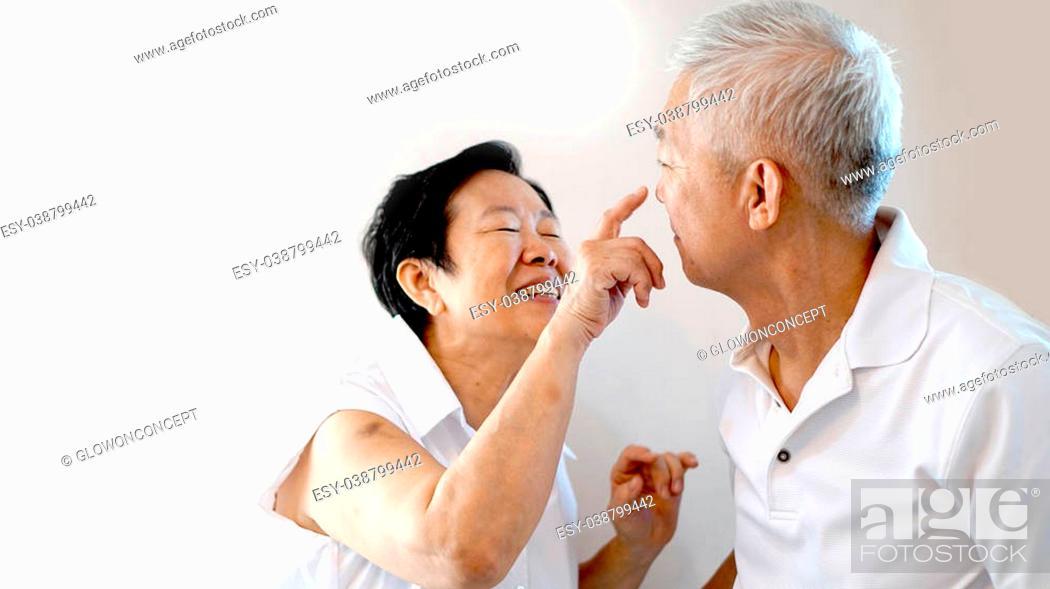 Stock Photo: Happy Asian senior couple on white background love and hug.