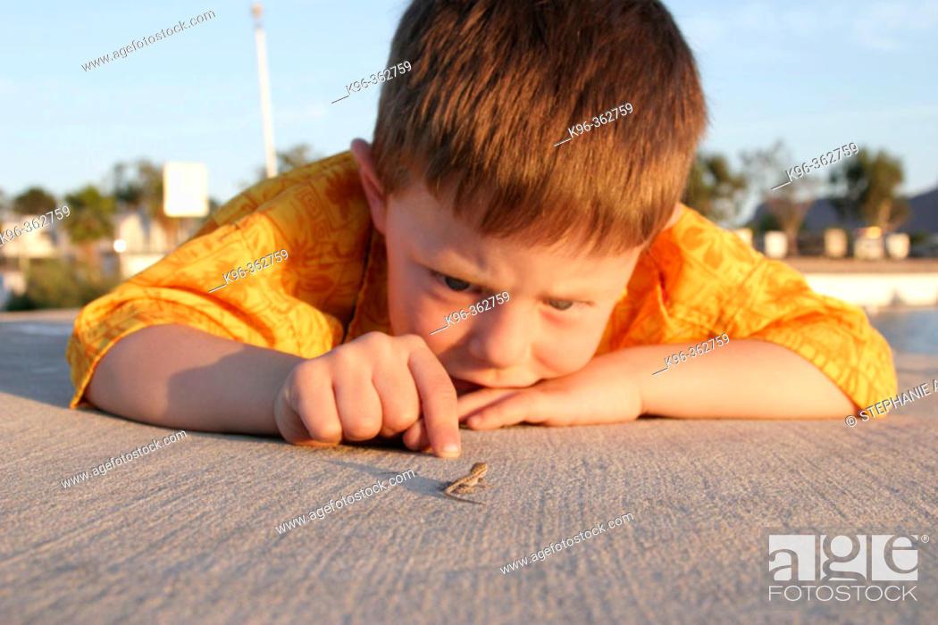 Stock Photo: Child and Lizard.