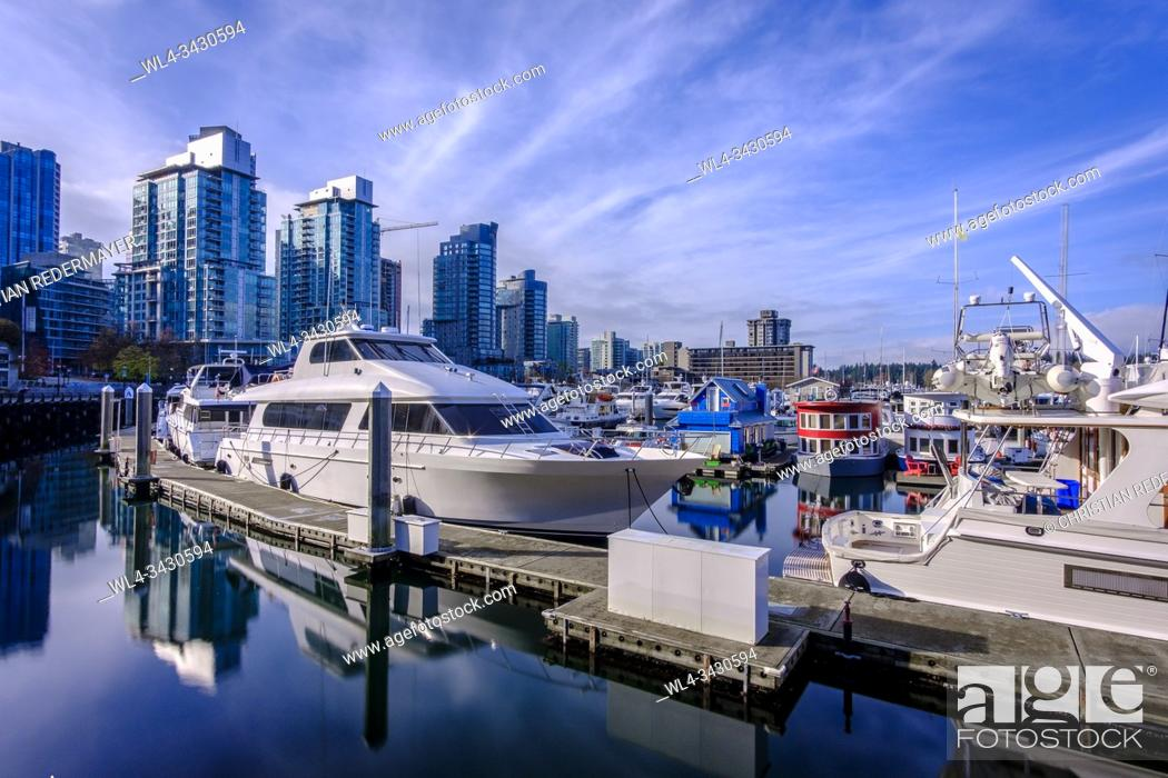 Stock Photo: Some tiny house boats in Coal Harbour , Vancouver, British Columbia during a wonderful sunny afternoon in November.