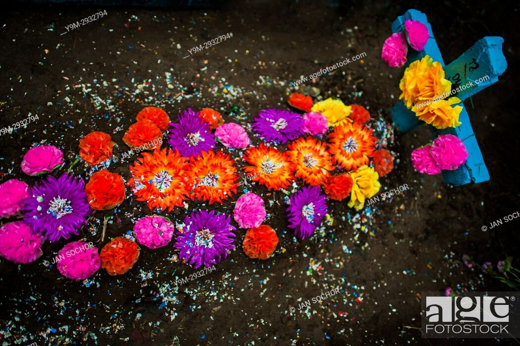 Stock Photo: A gravesite, decorated with colorful paper flowers and confetti, is seen during the Day of the Dead festivities at the cemetery in Izalco, El Salvador.