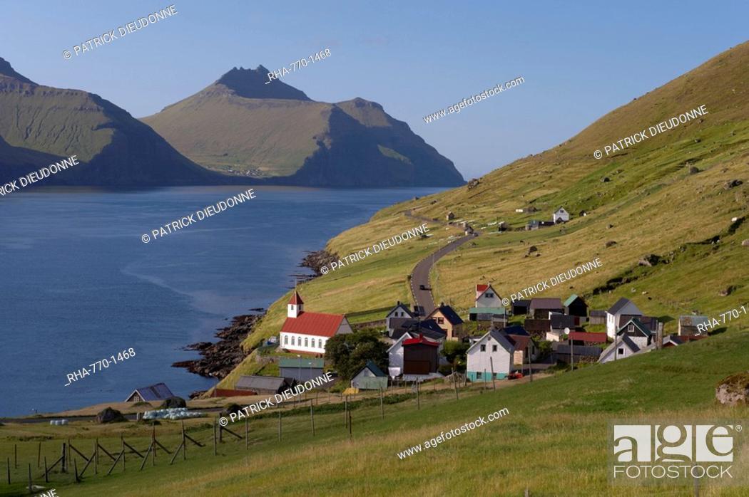 Stock Photo: Village of Kunoy, located on the west coast of the island Kunoy, impressively surrounded by high mountains, Kunoy Island, Nordoyar, Faroe Islands Faroes.