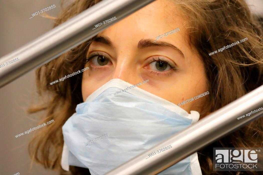 Stock Photo: Close up of a medium age woman wearing a face mask in the subway during the covid19 pandemic.