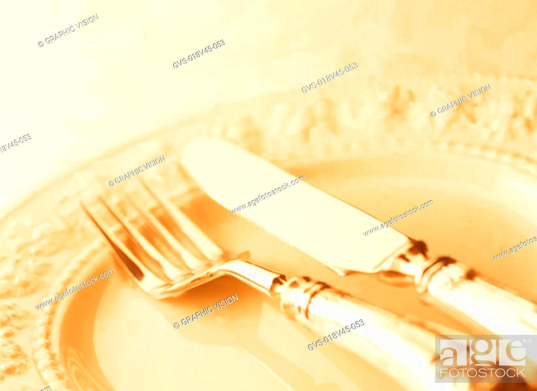 Imagen: Close Up of a Knife and Fork on a Plate.