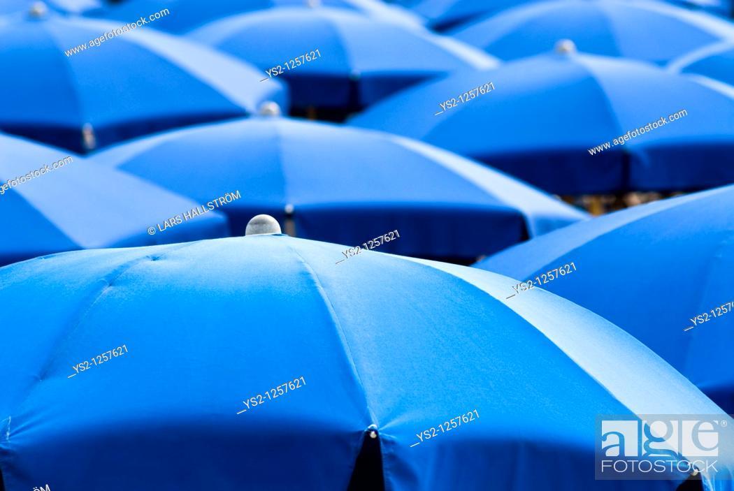Stock Photo: Blue sunshades, Italy, Europe.