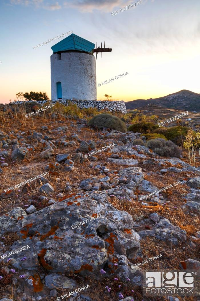Stock Photo: Old windmill near Chora village on Kimolos island in Greece. .