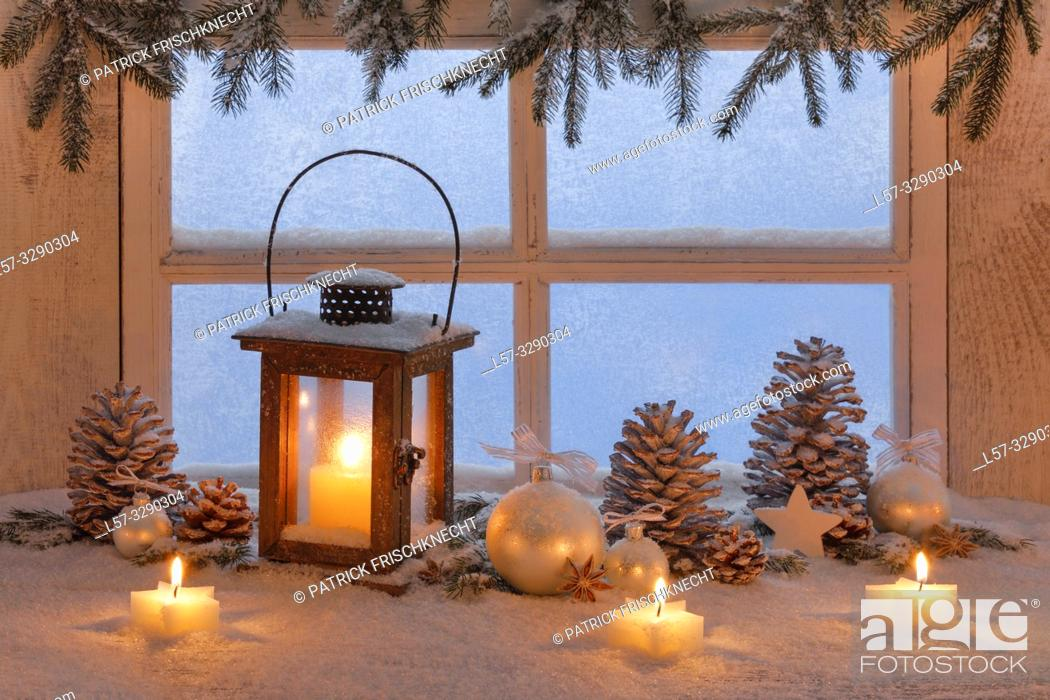 Stock Photo: wooden lantern on windowsill with christmas decoration.