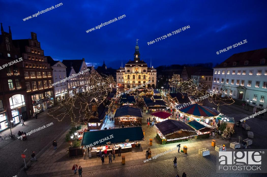 Stock Photo: View of the Christmas market at the city hall in Lueneburg, Germany, 29 November 2017. The Christmas market is open until 22 December.