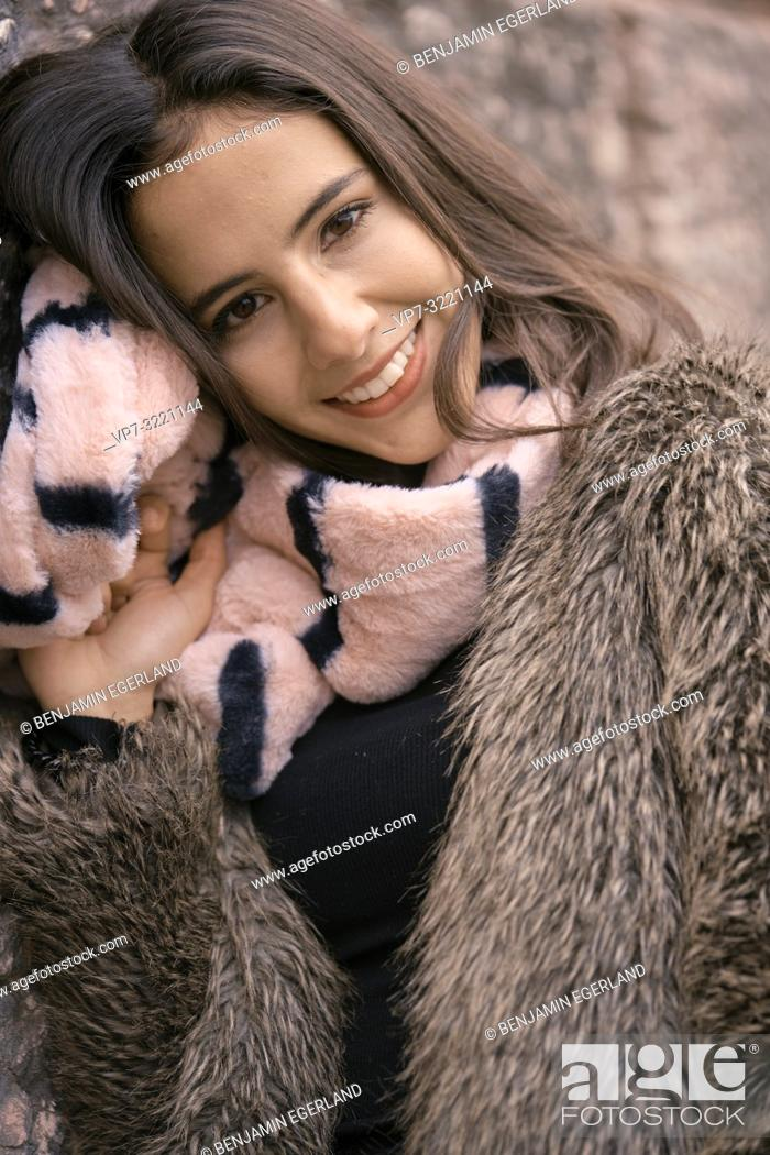 Stock Photo: portrait of smiling woman with scarf, happiness, in Munich, Germany.