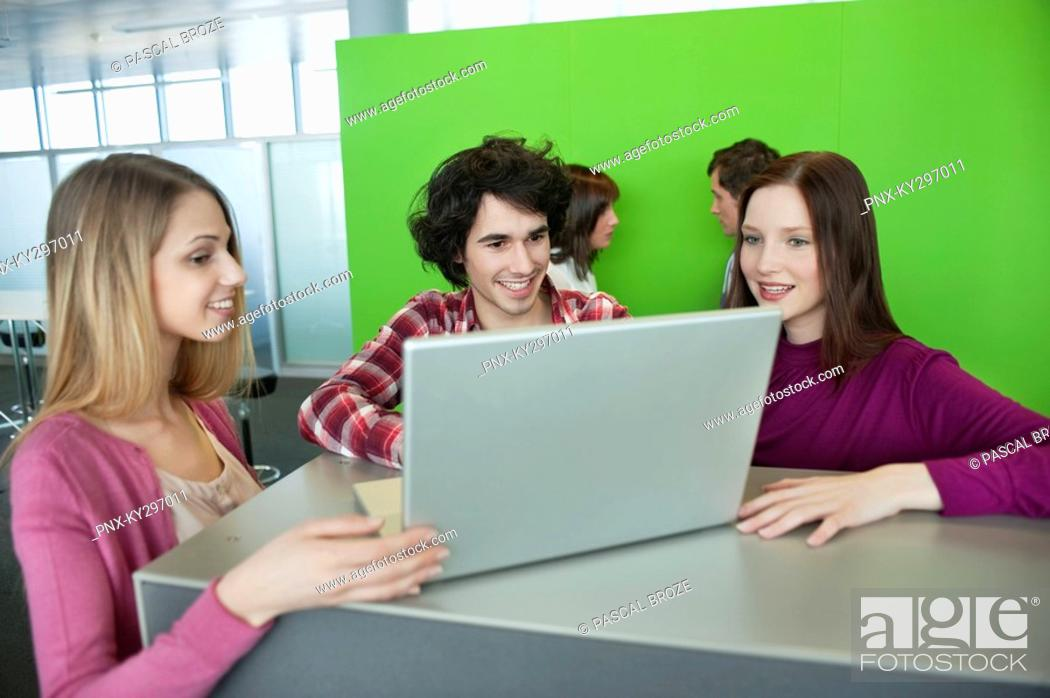 Stock Photo: Businessman using a laptop with his colleagues in an office.