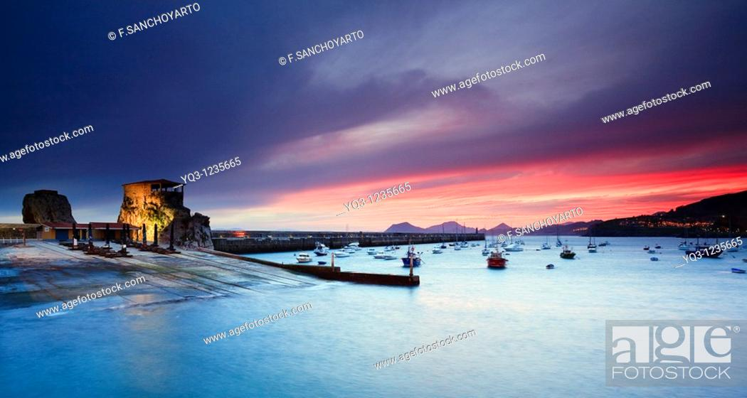 Stock Photo: Sunrise, Bay of Castro Urdiales, Cantabria, Northern Spain.