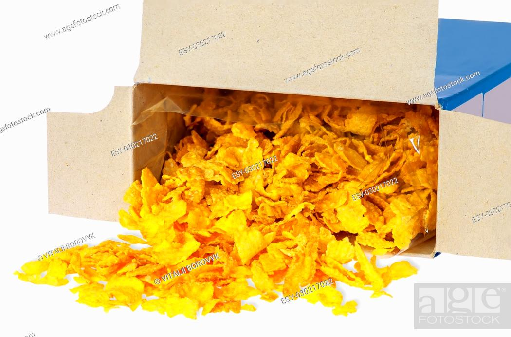 Stock Photo: Corn flakes spill out of cardboard box isolated on white background.
