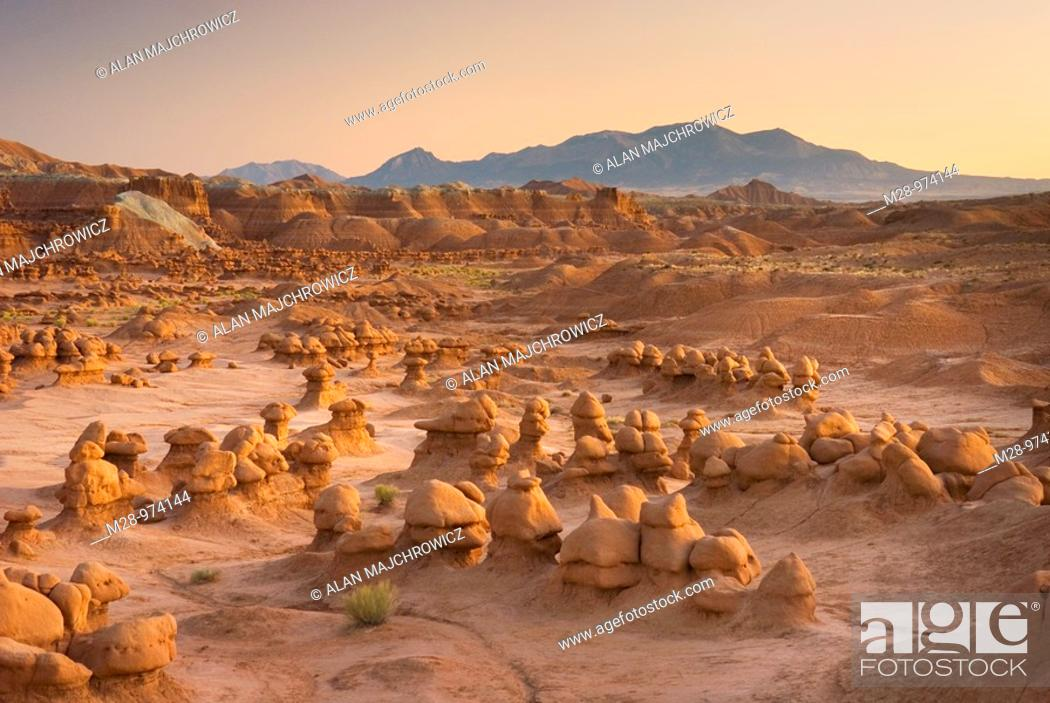 Stock Photo: Odd shaped hoodoos of Entrada Sandstone illuminated in evening afterglow, Goblin Valley State Park Utah USA.