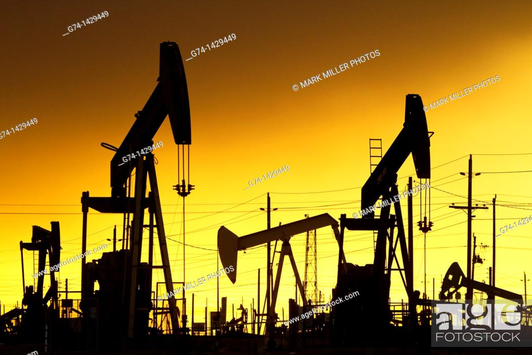 Stock Photo: Oil Pumps at work in oil and gas field USA.