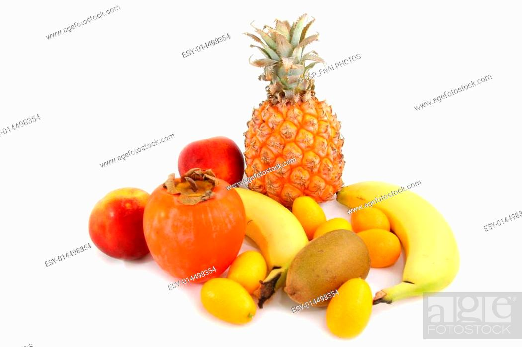 Stock Photo: several tropical fruits arranged over a white beackground.