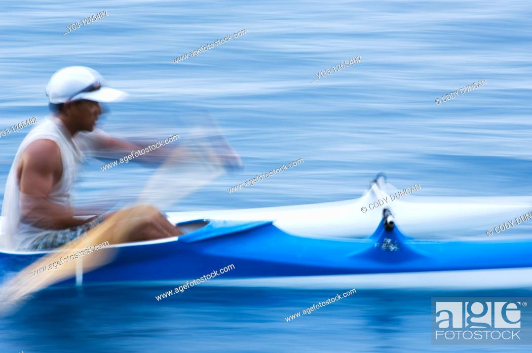 Stock Photo: person rows outrigger canoe, Morea, Tahiti.