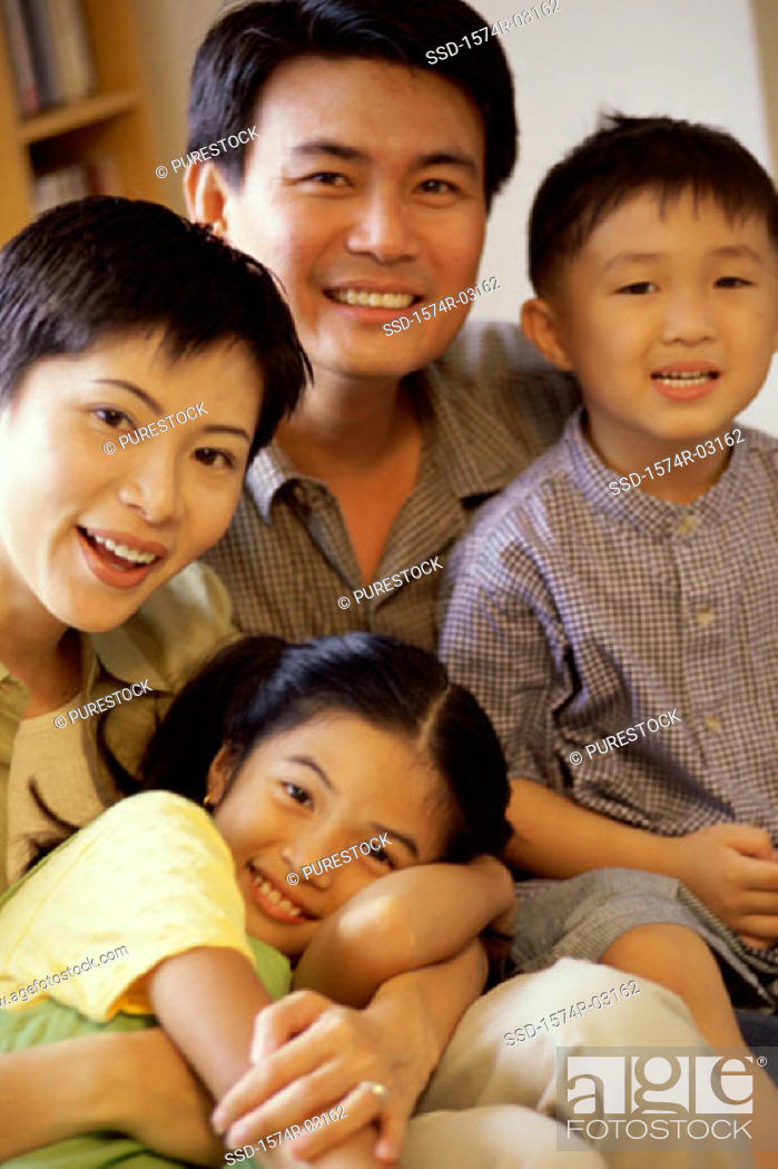 Stock Photo: Portrait of parents with their son and daughter.