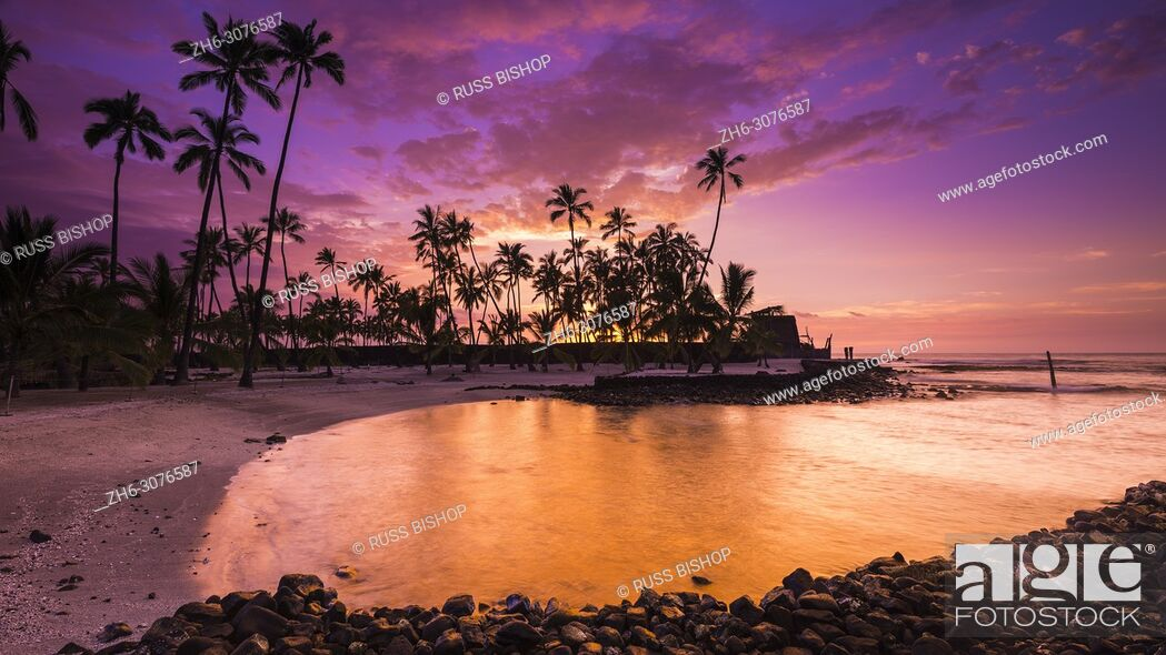 Stock Photo: Sunset over Pu'uhonua O Honaunau National Historic Park (City of Refuge), Kona Coast, Hawaii USA.