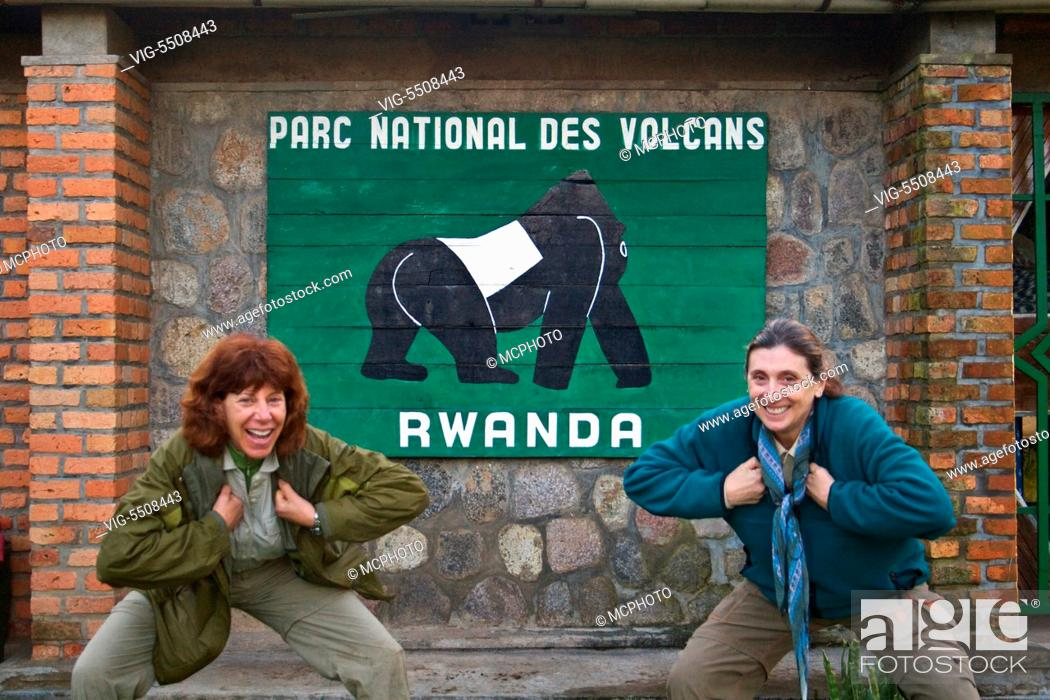 Stock Photo: VISITORS clown around in front of the sign to VOLCANOES NATIONAL PARK - RWANDA, AFRICA - Africa, 11/03/2007.