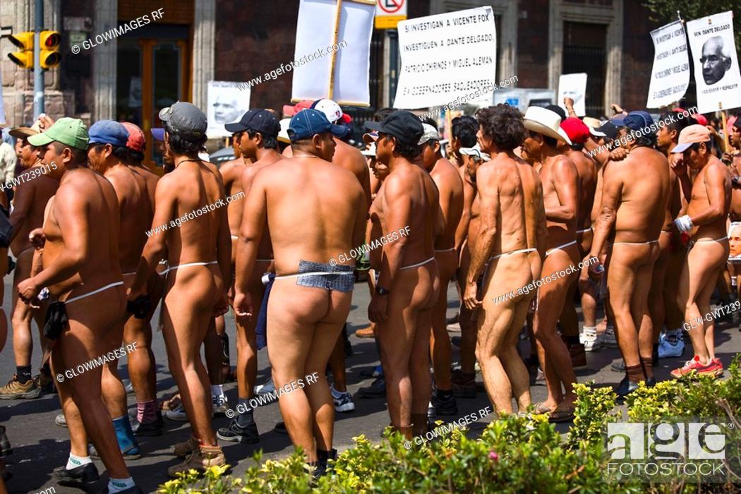 Stock Photo: Crowd of protestors demonstrating in street, Plaza De La Constitution, Mexico City, Mexico.