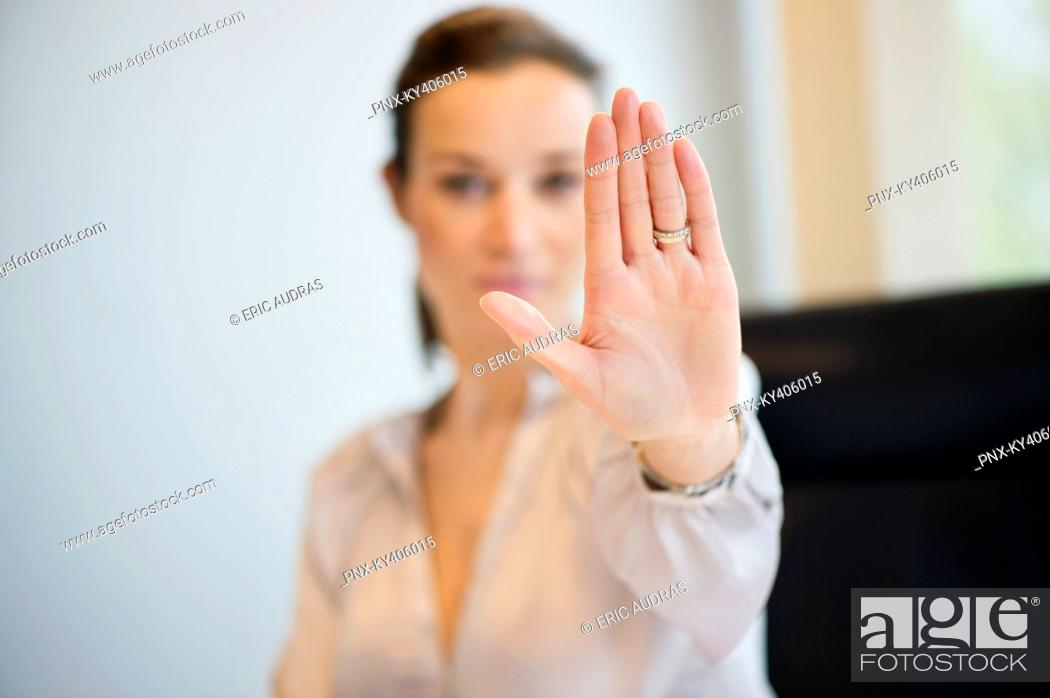 Stock Photo: Businesswoman showing her wedding ring with stop gesture.